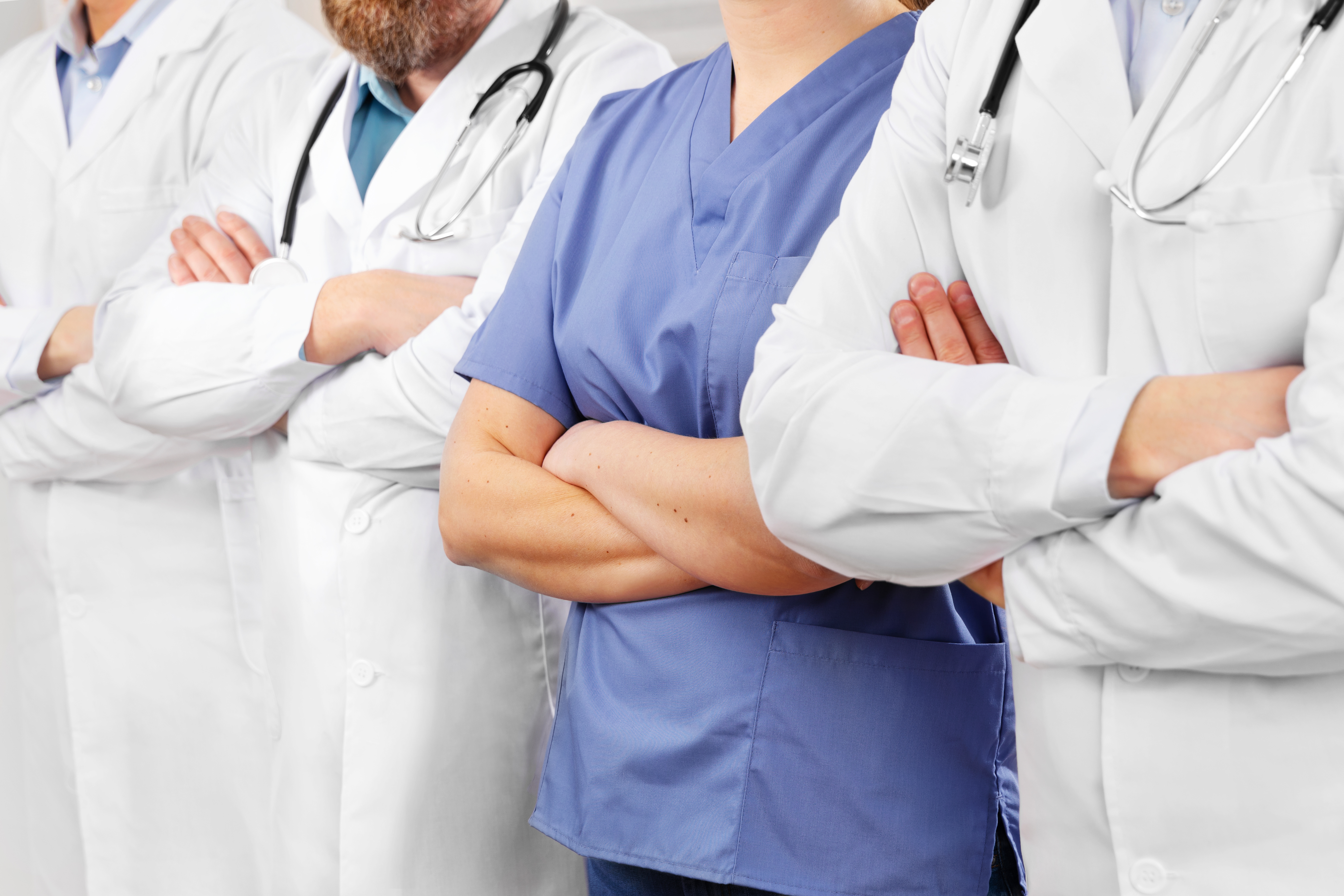 doctors-and-nurses-in-healthcare-team-with-arms-cr-Y4P52TH